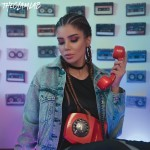 photo-of-woman-in-denim-jacket-holding-red-telephone-2587464 (3)